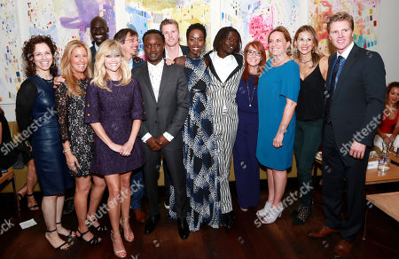 "Producer Kimberly Roth, Producer Ellen Schwartz, Ger Duany, Reese Witherspoon, Director Philippe Falardeau, Arnold Oceng, Thad Luckinbill, Kuoth Wiel, Emmanuel Jal, Writer Margaret Nagle, Producer Karen Kehela-Sherwood, Producer Molly Smith and Producer Trent Luckinbill seen at Warner Bros. ""The Good Lie"" Premiere at 2014 TIFF, in Toronto"