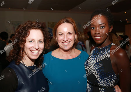 "Producer Kimberly Roth, Producer Karen Kehela-Sherwood and Kuoth Wiel seen at Warner Bros. ""The Good Lie"" Premiere at 2014 TIFF, in Toronto"