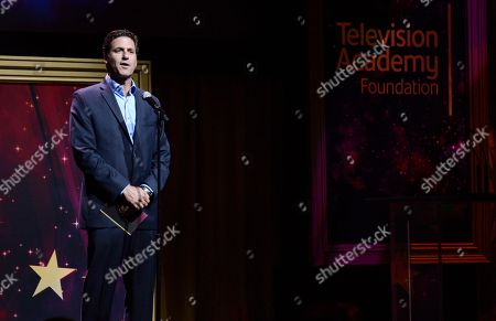 Stock Photo of Steven Levitan presents an award at the 36th College Television Awards, presented by the Television Academy Foundation at the Skirball Cultural Center in Los Angeles on