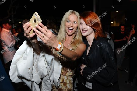 """Ellen Hollman, left, and Emily Beecham attend the """"Fear the Walking Dead"""" party held at the Hilton San Diego Gaslamp Quarter during Comic-Con 2015 on in San Diego, Calif"""