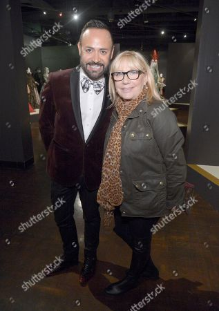 """Stock Image of Nick Verreos, left, and Ellen Mirojnick, costume designer of """"The Knick"""" seen at The 9th Annual Outstanding Art of Television Costume Design Exhibition opening at the FIDM Museum & Galleries on the Park, in Los Angeles. The Television Academy and FIDM Museum honored this yearâ?™s Emmy(R) Award winners in Outstanding Costume Design at the opening reception for this annual special exhibition"""