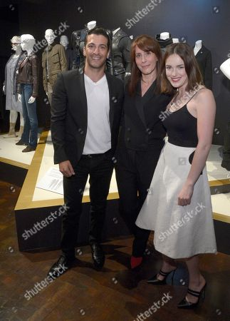 "Ann Foley, costume designer of ""Marvel's Agents of S.H.I.E.L.D"", center, and from left, Simon Kassianides and Elizabeth Henstridge seen at The 9th Annual Outstanding Art of Television Costume Design Exhibition opening at the FIDM Museum & Galleries on the Park, in Los Angeles. The Television Academy and FIDM Museum honored this yearâ?™s Emmy(R) Award winners in Outstanding Costume Design at the opening reception for this annual special exhibition"