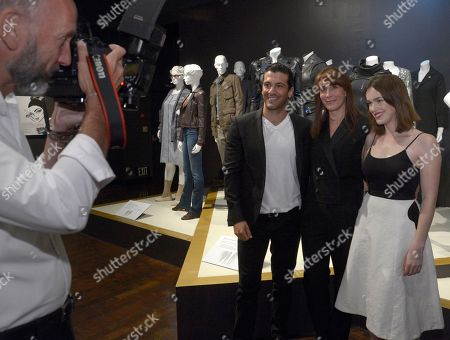 "Ann Foley, costume designer of ""Marvel's Agents of S.H.I.E.L.D"", center, and from left, Simon Kassianides and Elizabeth Henstridge seen at The 9th Annual Outstanding Art of Television Costume Design Exhibition opening at the FIDM Museum & Galleries on the Park, in Los Angeles. The Television Academy and FIDM Museum honored this year's Emmy(R) Award winners in Outstanding Costume Design at the opening reception for this annual special exhibition"