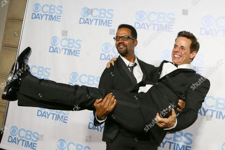 Kristoff St. John, left, and Christian LeBlanc arrive at the 2015 Daytime Emmy Awards CBS After Party at The Hollywood Athletic Club, in Los Angeles