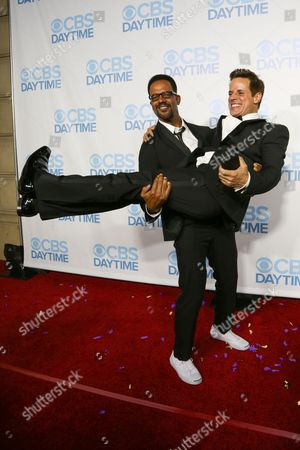 Stock Picture of Kristoff St. John, left, and Christian LeBlanc arrive at the 2015 Daytime Emmy Awards CBS After Party at The Hollywood Athletic Club, in Los Angeles