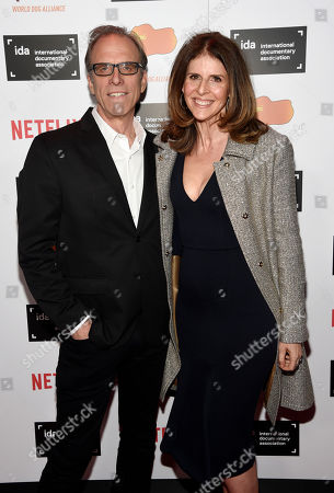 Kirby Dick, left, and Amy Ziering pose together at the 2015 IDA Documentary Awards at Paramount Studios, in Los Angeles