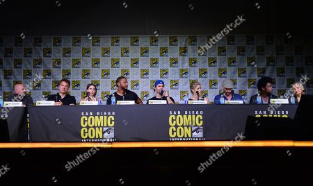 "Writer and producer Marc Guggenheim, from left, actors John Barrowman, Willa Holland, David Ramsey, Stephen Amell, Emily Bett Rickards, Paul Blackthorne, Echo Kellum, and producer and writer Wendy Mericle attend the ""Arrow"" panel on day 3 of Comic-Con International, in San Diego"