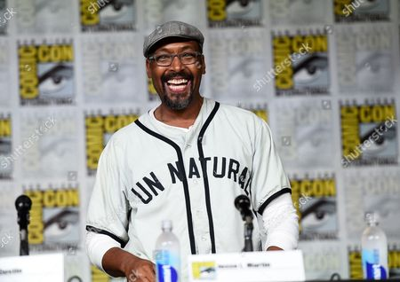 """Jesse L. Martin walks on stage at """"The Flash"""" panel on day 3 of Comic-Con International, in San Diego"""