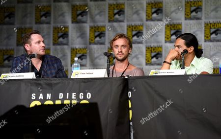 "Writer Aaron Helbing, left, and actors Tom Felton, and Carlos Valdes attend ""The Flash"" panel on day 3 of Comic-Con International, in San Diego"