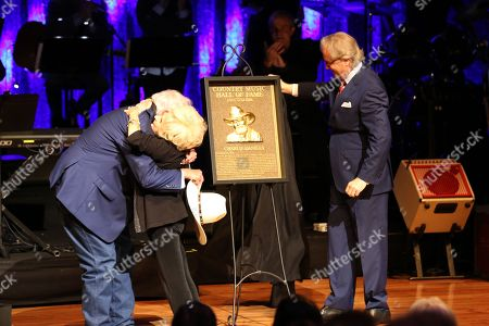 From left, artist and Country Music Hall of Fame inductee Charlie Daniels gets a hug from artist Brenda Lee with Country Music Hall of Fame Director Kyle Young at the Country Music Hall of Fame Medallion Ceremony at the Country Music Hall of Fame and Museum on in Nashville, Tenn