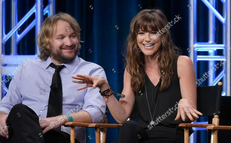 "Lenny Jacobson, left, and Devin Kelley participate in the ""Frequency"" panel during The CW Television Critics Association summer press tour, in Beverly Hills, Calif"