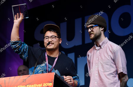 """Daniel Kwan, left, and Daniel Scheinert, co-directors of """"Swiss Army Man,"""" accept the U.S. Dramatic Directing Award during the 2016 Sundance Film Festival Awards Ceremony, in Park City, Utah"""