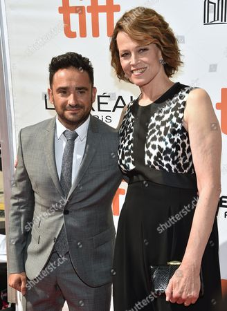 """Stock Picture of Director J. A. Bayona, left, and Sigourney Weaver arrive at the """"A Monster Calls"""" premiere on day 3 of the Toronto International Film Festival at the Roy Thomson Hall, in Toronto"""
