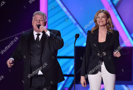 Stock Image of Dan Dotson, left, and Rene Russo present the lifetime achievement award at the 20th annual Critics' Choice Movie Awards at the Hollywood Palladium, in Los Angeles