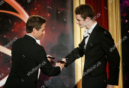 """Stock Photo of Scott Wolf presents Jack Carpenter of Champlain College with the award in the Alternative category for """"Lake Night with Jack Carpenter"""" at the 35th College Television Awards, presented by the Television Academy Foundation at The Leonard H. Goldenson Theatre in the NoHo Arts District, in Los Angeles"""