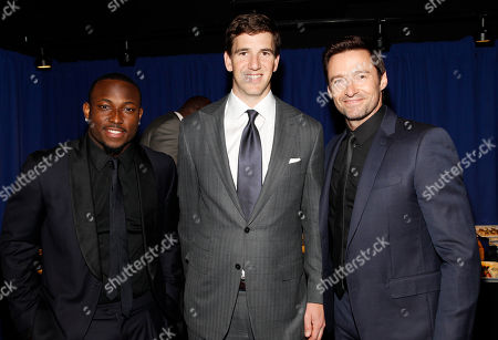 LeSean McCoy of the Philadelphia Eagles, from the left, Eli Manning of the New York Giants and actor Hugh Jackman at the 3rd annual NFL Honors at Radio City Music Hall, in New York