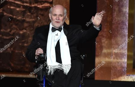 Stock Image of Ron Kovic speaks on stage at the 42nd AFI Lifetime Achievement Award Tribute Gala at the Dolby Theatre, in Los Angeles