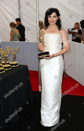 SEPTEMBER 18: Julianna Marguiles poses in the trophy room during the Academy of Television Arts & Sciences 63rd Primetime Emmy Awards at Nokia Theatre L.A. Live on in Los Angeles, California