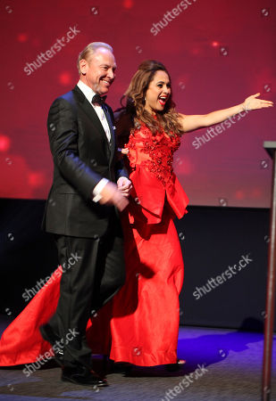 Stock Image of Rick Reiff, left, and Elizabeth Espinosa present the Emmy for Sports Special at the L.A. Area Emmy Awards presented at the Television Academy's new Saban Media Center, in the NoHo Arts District in Los Angeles