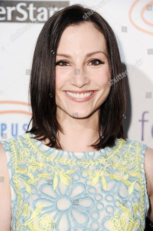 Heather McComb arrives at the 6th Annual Get Lucky For Lupus Poker Tournament, in Los Angeles