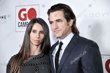Tharita Catulle, left, and Dermot Mulroney arrive at the 6th Annual Go Go Gala at the Bel Air Bay Club on in Pacific Palisades, Calif