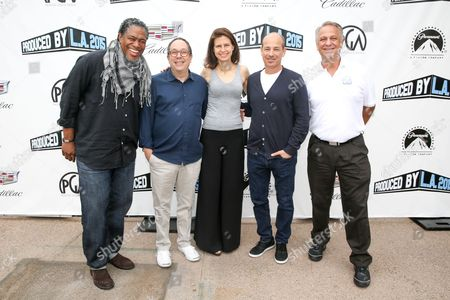 Ali LeRoi, from left, Mark Gordon, Sarah Timberman, Howard Gordon and Vance Van Petten pose at the 7th Annual Produced By Conference presented by Producers Guild of America at Paramount Pictures Studios on in Los Angeles