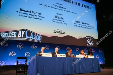 Mark Gordon, from left, Howard Gordon, Ali LeRoi and Sarah Timberman speak at the 7th Annual Produced By Conference presented by Producers Guild of America at Paramount Pictures Studios on in Los Angeles