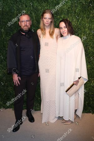 Lexi Boling (center) and Ryan Roche (R)