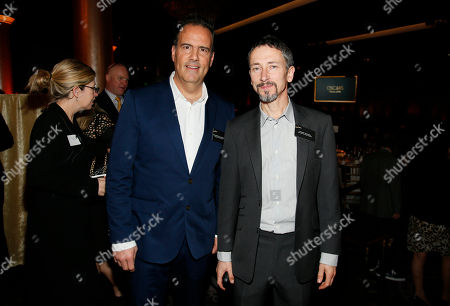 Christopher Scarabosio, left, and Stuart Wilson attend the 88th Academy Awards Nominees Luncheon at The Beverly Hilton hotel, in Beverly Hills, Calif