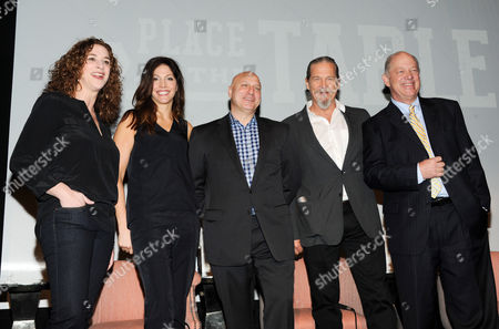 "Filmmaker Kristi Jacobson, from left, filmmaker Lori Silverbush, restaurateur and executive producer, Tom Colicchio, actor and End Hunger Network founder, Jeff Bridges, and Share Our Strength founder and CEO, Bill Shore pose together before a press conference for the film ""A Place At The Table"" at the Crosby Street hotel on in New York"
