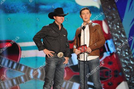 Scott McCreery and Trevor Brazile appear on stage during the American Country Awards, in Las Vegas