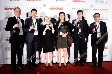 Jonathan Wolf, Executive Vice President & Managing Director of the American Film Market, Haifeng Chen, Vice President of Weying Technology, Jean M. Prewitt, President & CEO of IFTA, Jing Zhang, Peng Chen, China Beijing Film Delegation, and Luke Xiang, VP and Head of International of Beijing Weying Technology Co., Ltd., cheers at American Film Market China Reception at the Loews Santa Monica Beach Hotel on Wendeday, in Santa Monica, Calif