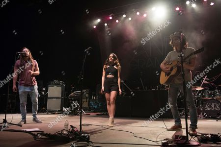 Stock Image of Michael Castro, from left, Jackie Castro and Jason Castro open up for Andy Grammar at Mizner Park Amphitheater on in Boca Raton, Fla