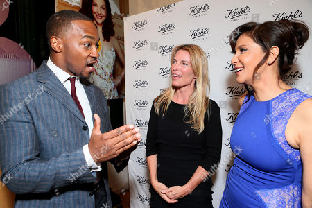 From left, Anthony Mackie, executive director of Recycle Across America Mitch Hedlund, and Laurie Lynn Stark are seen at Ashley Judd & Anthony Mackie host Earth Day party at Kiehl's on in Santa Monica, Calif