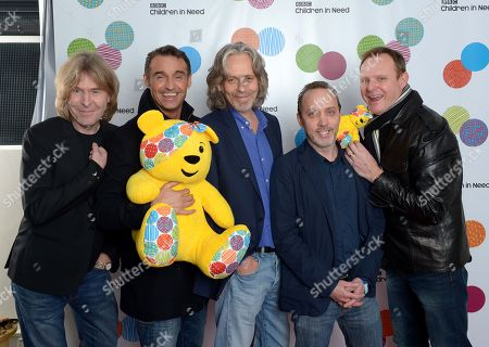 Wet Wet Wet, from left to right, Graeme Duffin, Marti Pellow, Graeme Clark, Neil Mitchell and Tommy Cunningham pose backstage at the BBC Children in Need Appeal Show, live from BBC Elstree Studios in London, on