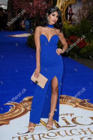 Jasmine Walia poses for photographers upon arrival at the European premiere of the film 'Alice Through The Looking Glass' at a central London cinema, London
