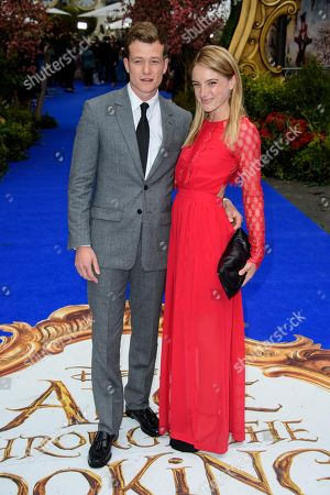 British actor, Ed Speleers and Asia Macey pose for photographers upon arrival at the European premiere of the film 'Alice Through The Looking Glass' at a central London cinema, London
