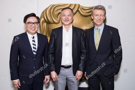 From left, Chairman of the Asian Film Awards Academy Dr. Wilfred Wong Ying-Wai, Johnnie To and Vice-President of BAFTA Duncan Kenworthy OBE attend a Johnnie To A Life in Pictures question and answer event, at Bafta headquarters in London, Britain