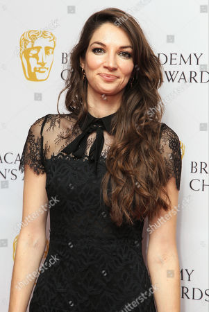 Illusionist Katherine Mills poses for photographers as she arrives for the British Academy Children's Awards in London