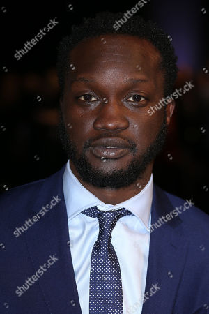 Arnold Oceng poses for photographers upon arrival at the The British Independent Film Awards in London