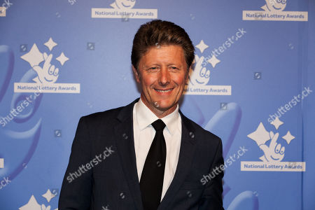 TV Presenter Charlie Stayt poses for photographers upon arrival at the National Lottery Awards, in central London