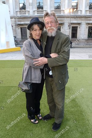 Anwen Rees-Meyers and John Hurt attend the Royal Academy Summer Exhibition preview party in London on