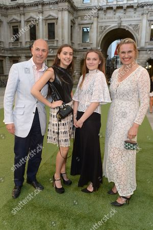 Sarah Walter, right, husband Dylan Jones, left and their two daughters Edie and Georgia attend the Royal Academy Summer Exhibition preview party in London on