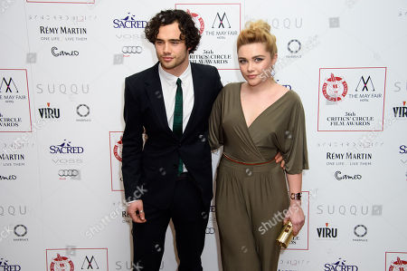 Toby Sebastian, left, and Florence Pugh pose for photographers at the Critics Circle Awards at a central London venue, London