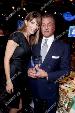 Jennifer Flavin and Sylvester Stallone pose with the Heart of Hollywood Award at Cedars-Sinai Board of Governors honoring Adele and Beny Alagem and Sylvester Stallone at 2016 Annual Gala at Beverly Hilton Hotel, in Beverly Hills
