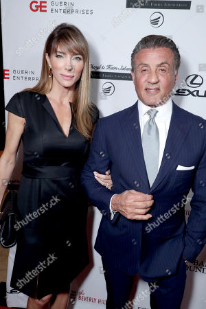 Stock Photo of Jennifer Flavin and Sylvester Stallone seen at Cedars-Sinai Board of Governors honoring Adele and Beny Alagem and Sylvester Stallone at 2016 Annual Gala at Beverly Hilton Hotel, in Beverly Hills