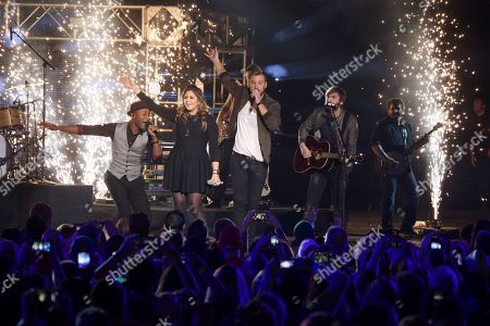 From left, Aloe Blacc performs with Hilary Scott, Charles Kelley and Dave Haywood of Lady Antebellum at the CMT Ultimate KickOff Party at Kay Bailey Hutchison Convention Center, in Dallas