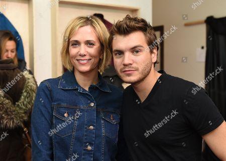 Kristen Wiig, left, and Emile Hirsch attend the Eddie Bauer Adventure House at Sundance Film Festival, in Park City, Utah
