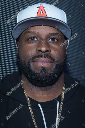 Funkmaster Flex poses for a photo backstage at Pier 36, in New York