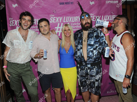 Rose Boys and White Girl Rose founders, Tanner Cohen, David Oliver Cohen, Fat Jew and Alexander Ferzan, left to right, pose with Tara Reid at the first birthday party for White Girl Rose hosted by Elite Daily at The Dream Downtown, in New York